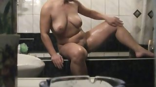 mature lady takes a shower